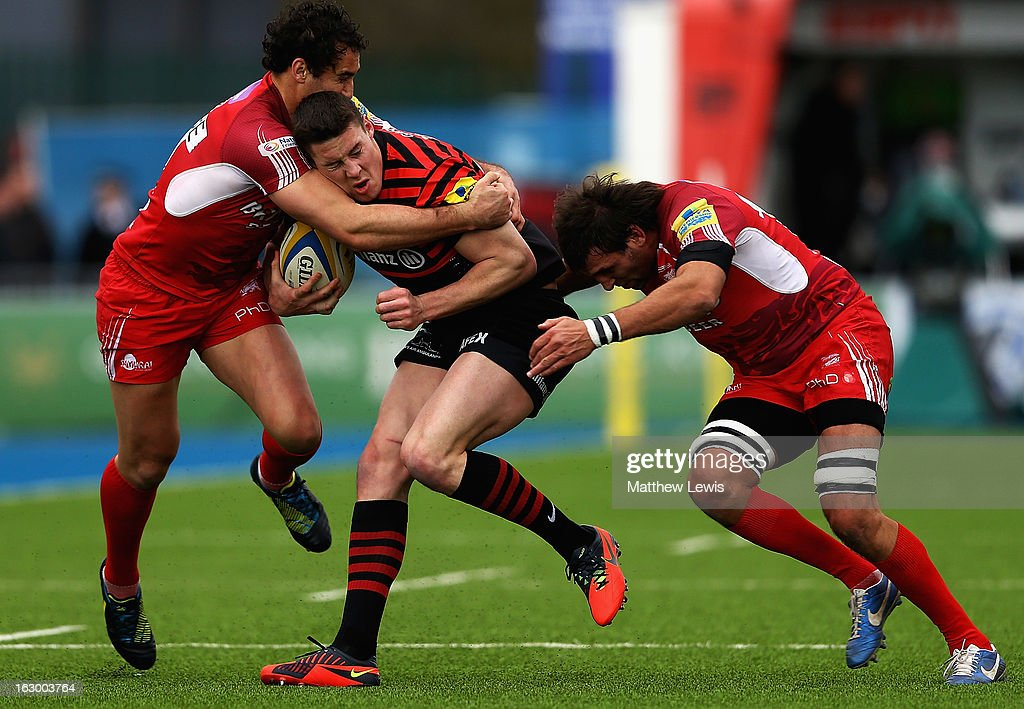 Joel Tomkins of Saracens is caught by the London welsh defence during the Aviva Premiership match between Saracens and London Welsh at Allianz Park on March 3, 2013 in Barnet, England.