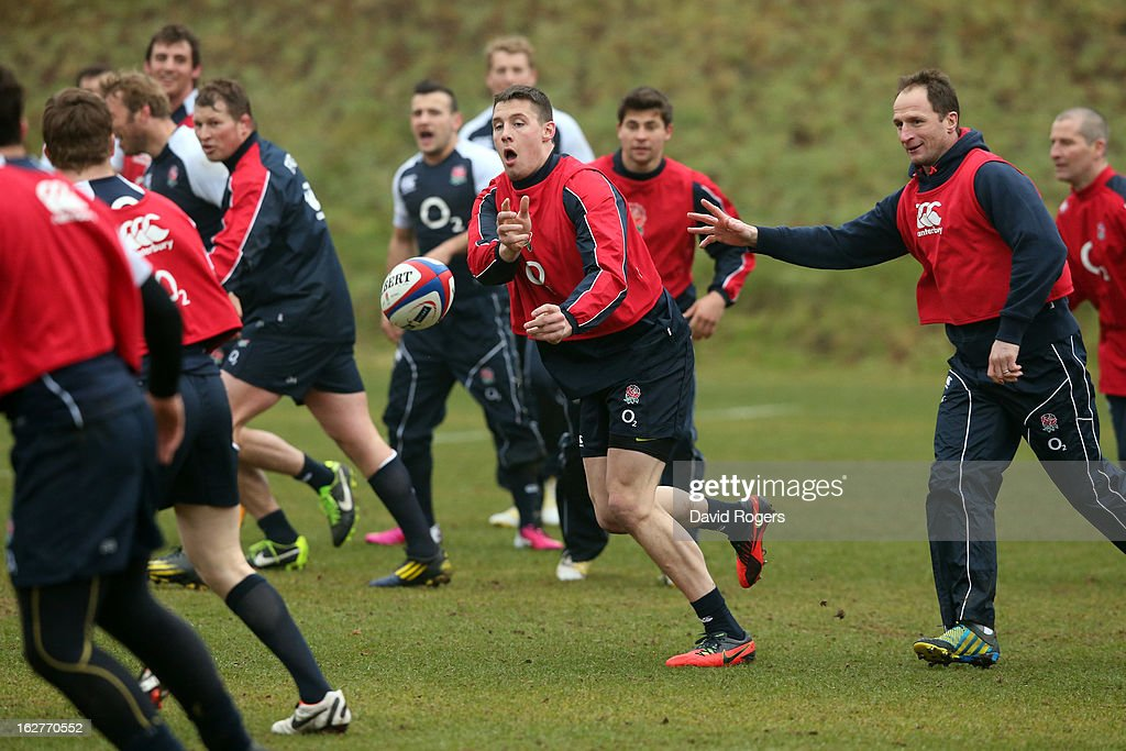 Joel Tomkins passes the ball during the England training session held at Pennyhill Park on February 26, 2013 in Bagshot, England.