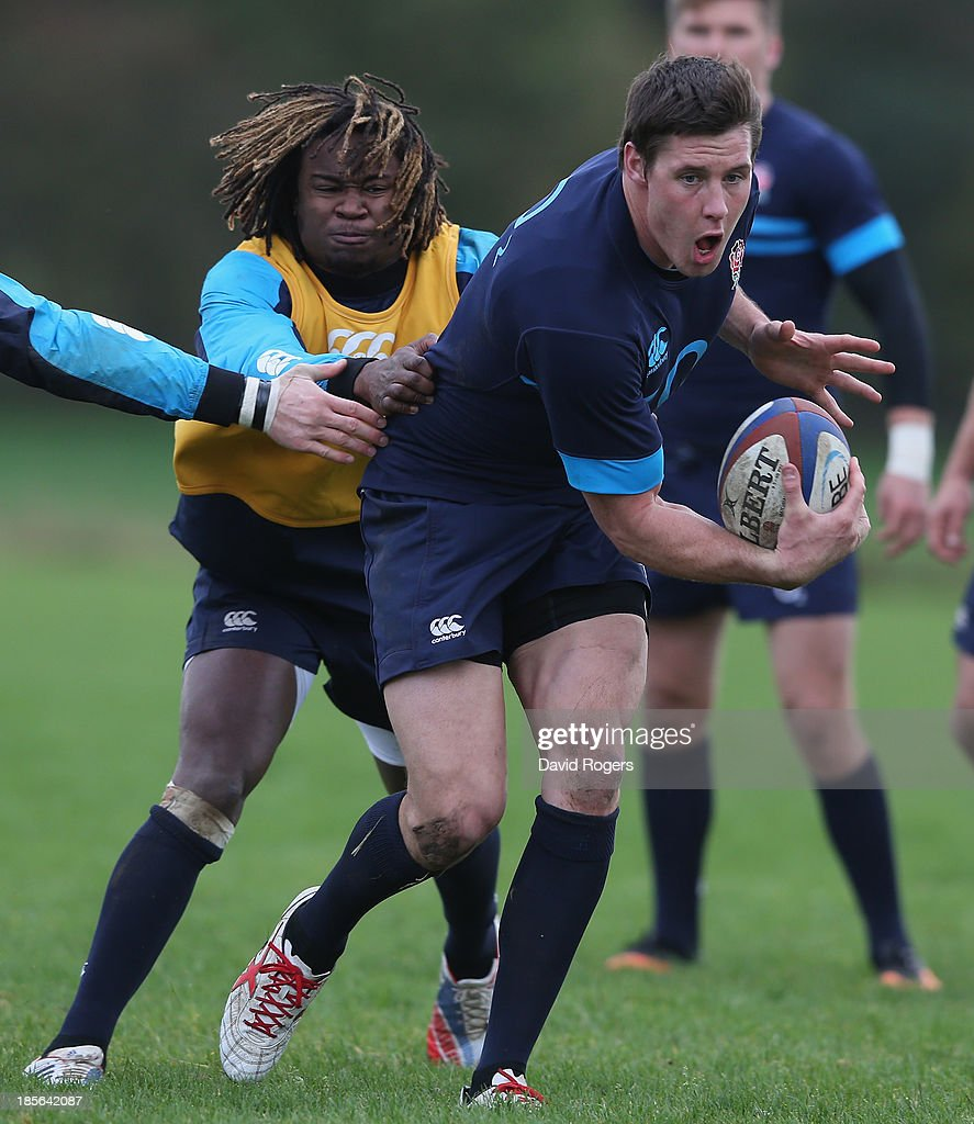 <a gi-track='captionPersonalityLinkClicked' href=/galleries/search?phrase=Joel+Tomkins&family=editorial&specificpeople=4294522 ng-click='$event.stopPropagation()'>Joel Tomkins</a> runs with the ball during the England training session held at West Park Leeds Rugby Club on October 23, 2013 in Leeds, England.