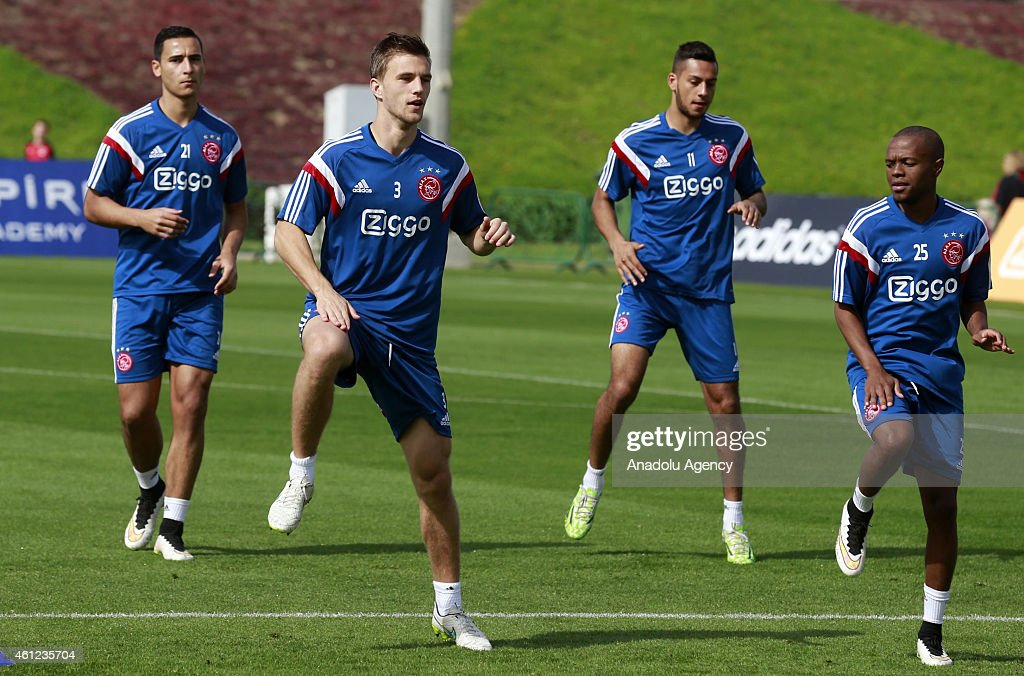 Joel Veltman (L2), Anwar El Ghazi (L), <a gi-track='captionPersonalityLinkClicked' href=/galleries/search?phrase=Ricardo+Kishna&family=editorial&specificpeople=12335040 ng-click='$event.stopPropagation()'>Ricardo Kishna</a> (R2) and <a gi-track='captionPersonalityLinkClicked' href=/galleries/search?phrase=Thulani+Serero&family=editorial&specificpeople=6234374 ng-click='$event.stopPropagation()'>Thulani Serero</a>(R) of AFC Ajax attend the team's training session at Aspire Sport Academy in Doha, Qatar on January 9,2015 before the friendly match against German team Schalke 04.