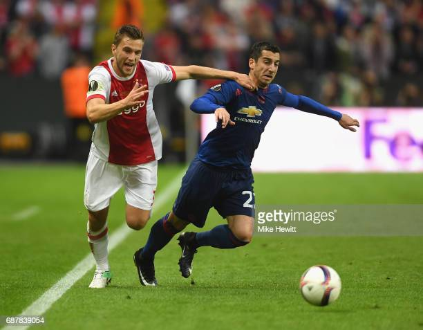 Joel Veltman of Ajax and Henrikh Mkhitaryan of Manchester United in action during the UEFA Europa League Final between Ajax and Manchester United at...