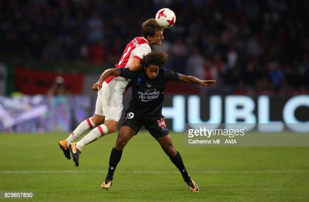 Joel Veltman of Ajax and Vincent Marcel of OGC Nice during the UEFA Champions League Qualifying Third Round match between Ajax and OSC Nice at...