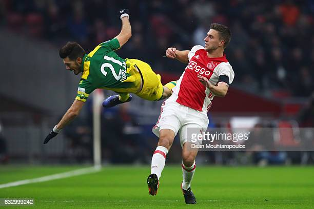Joel Veltman of Ajax battles for the ball with Edouard Duplan of ADO Den Haag during the Eredivisie match between Ajax Amsterdam and ADO Den Haag...