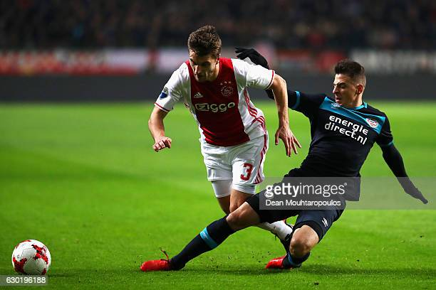 Joel Veltman of Ajax battles for the ball with Santiago Arias of PSV during the Eredivisie match between Ajax Amsterdam and PSV Eindhoven held at...