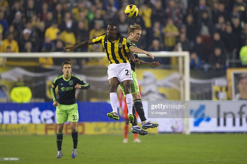 Joel Veltman of Ajax, Gael Kakuta of Vitesse, Christian Poulsen of Ajax during the Dutch Eredivise match between Vitesse Arnhem and Ajax Amsterdam at the Gelredome on January 27, 2013 in Arnhem, The Netherlands.