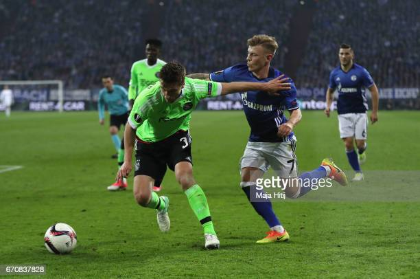 Joel Veltman of Ajax holds off Max Meyer of FC Schalke 04 during the UEFA Europa League quarter final second leg match between FC Schalke 04 and Ajax...