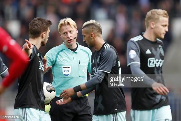 Joel Veltman of Ajax referee Kevin Blom Hakim Ziyech of Ajax Donny van de Beek of Ajaxduring the Dutch Eredivisie match between PSV Eindhoven and...