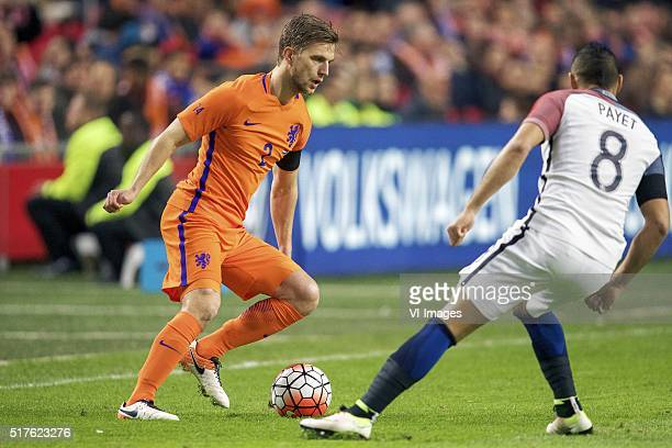 Joel Veltman of Holland Dimitri Payet of France during the friendly match between Netherlands and France on March 25 2016 at the Amsterdam Arena in...