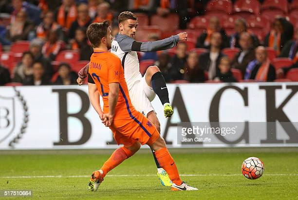 Joel Veltman of the Netherlands and Antoine Griezmann of France in action during the international friendly match between Netherlands and France at...
