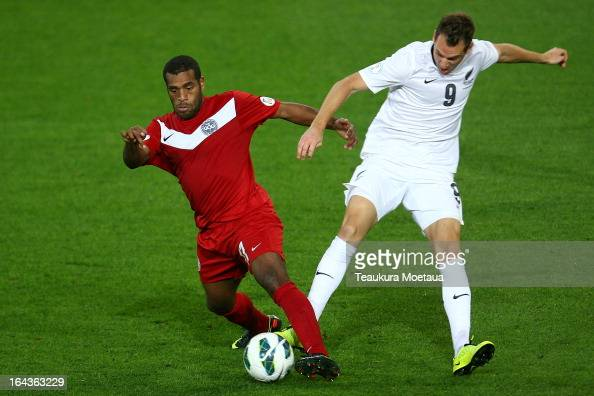 Joel Wakanumune of New Caledonia competes for the ball against Shane Smeltz of the New Zealand All Whites during the FIFA World Cup Qualifier match...