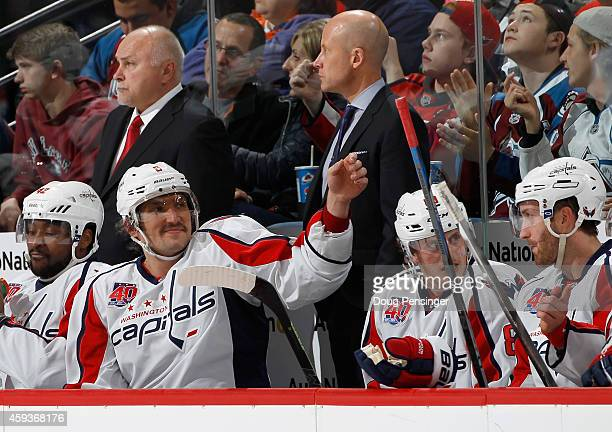 Joel Ward Alex Ovechkin Nate Schmidt and Brooks Orpik of the Washington Capitals take a break on the bench as head coach Barry Trotz and assistant...