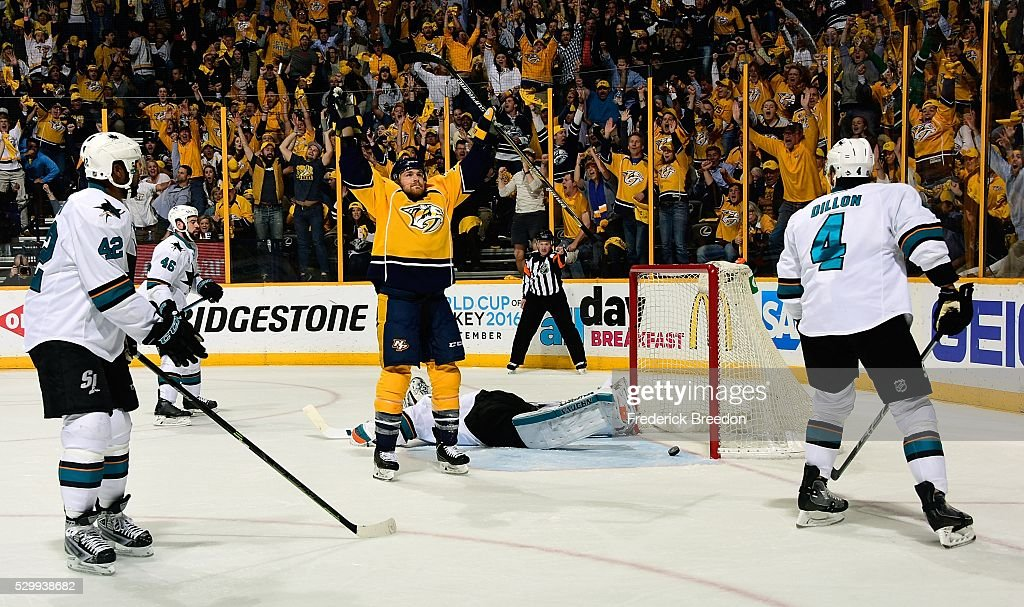 Joel Ward #42 and Brenden Dillon #4 of the San Jose Sharks watch as Colin Wilson #33 of the Nashville Predators holds his hands up in celebration after scoring the game tying goal during the third period of Game Six of the Western Conference Second Round during the 2016 NHL Stanley Cup Playoffs at Bridgestone Arena on May 9, 2016 in Nashville, Tennessee.