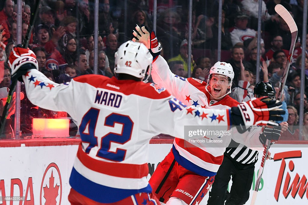 Joel Ward and Evgeny Kuznetsov of the Washington Capitals celebrate after scoring a goal against the Montreal Canadiens in the NHL game at the Bell...