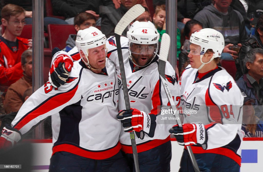 Joel Ward #42 and <a gi-track='captionPersonalityLinkClicked' href=/galleries/search?phrase=Mikhail+Grabovski&family=editorial&specificpeople=2560547 ng-click='$event.stopPropagation()'>Mikhail Grabovski</a> #84 of the Washington Capitals congratulate <a gi-track='captionPersonalityLinkClicked' href=/galleries/search?phrase=Jason+Chimera&family=editorial&specificpeople=211264 ng-click='$event.stopPropagation()'>Jason Chimera</a> #25 who scored against the Vancouver Canucks during their NHL game at Rogers Arena on October 28, 2013 in Vancouver, British Columbia, Canada.