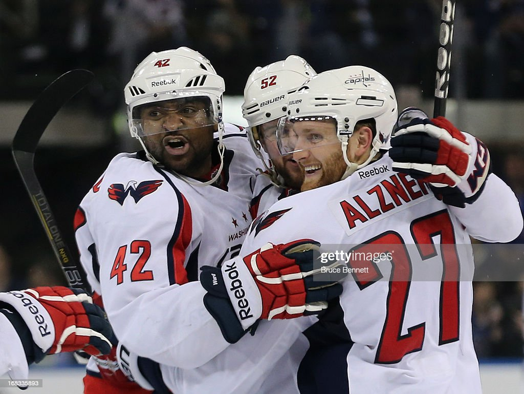 Joel Ward #42, Mike Green #52 and <a gi-track='captionPersonalityLinkClicked' href=/galleries/search?phrase=Karl+Alzner&family=editorial&specificpeople=3938829 ng-click='$event.stopPropagation()'>Karl Alzner</a> #27 of the Washington Capitals celebrate Alzners goal at 7:31 of the third period against the New York Rangers in Game Four of the Eastern Conference Quarterfinals during the 2013 NHL Stanley Cup Playoffs at Madison Square Garden on May 8, 2013 in New York City. The Rangers defeated the Capitals 4-3.