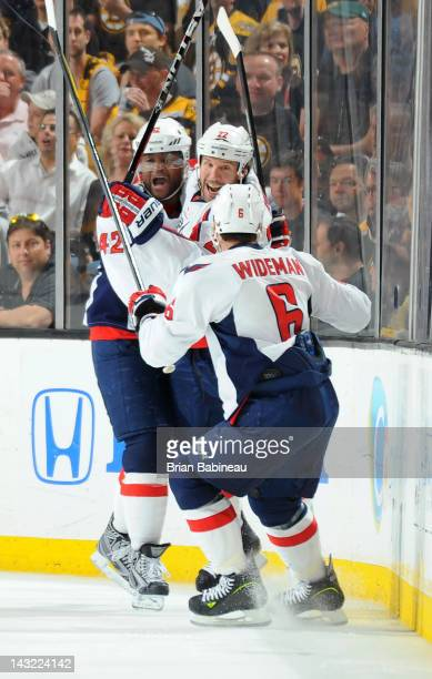 Joel Ward Mike Knuble and Dennis Wideman of the Washington Capitals celebrate a goal against the Boston Bruins in Game Five of the Eastern Conference...