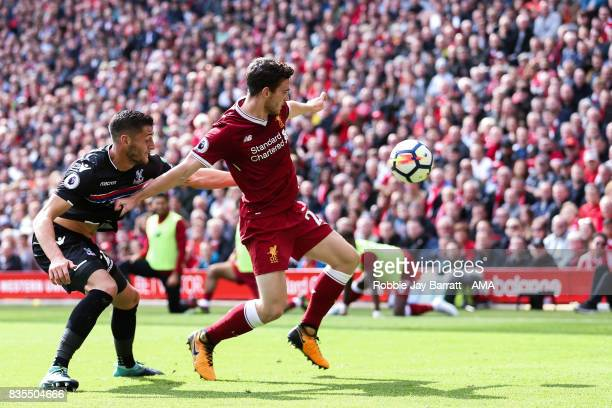 Joel Ward of Crystal Palace and Andrew Robertson of Liverpool during the Premier League match between Liverpool and Crystal Palace at Anfield on...