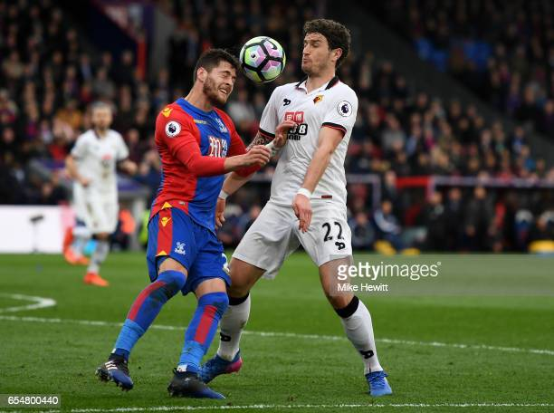 Joel Ward of Crystal Palace and Daryl Janmaat of Watford battle to win a header during the Premier League match between Crystal Palace and Watford at...