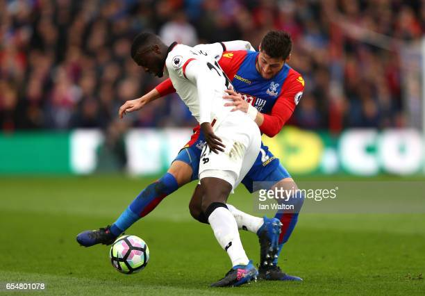 Joel Ward of Crystal Palace and M'Baye Niang of Watford battle for possession during the Premier League match between Crystal Palace and Watford at...