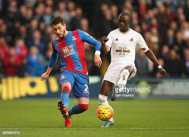 Joel Ward of Crystal Palace and Modou Barrow of Swansea City compete for the ball during the Barclays Premier League match between Crystal Palace and...