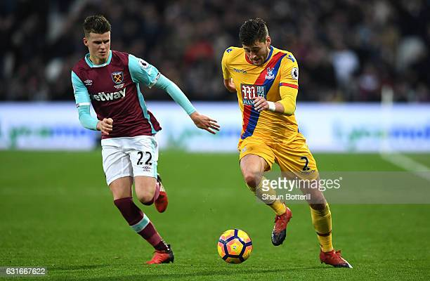 Joel Ward of Crystal Palace attempts to take the ball past Sam Byram of West Ham United during the Premier League match between West Ham United and...