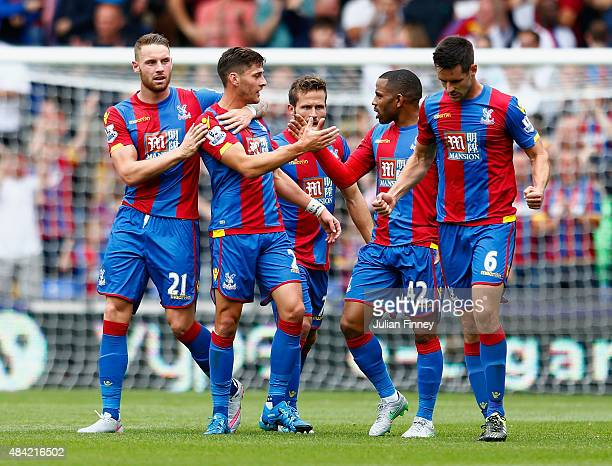 Joel Ward of Crystal Palace celebrates scoring his team's opening goal with team mates during the Barclays Premier League match between Crystal...