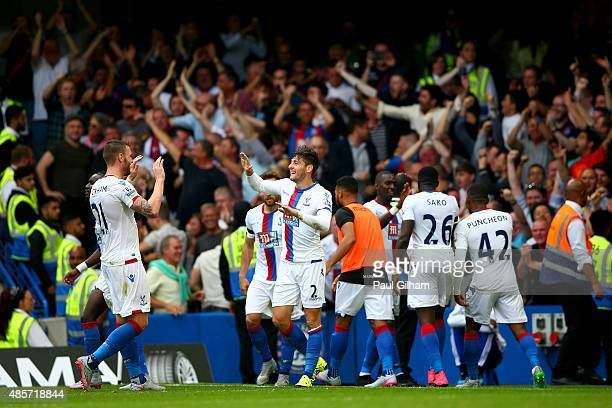 Joel Ward of Crystal Palace celebrates scoring his team's second goal during the Barclays Premier League match between Chelsea and Crystal Palace at...