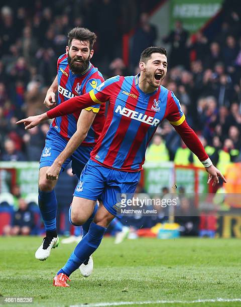 Joel Ward of Crystal Palace celebrates scoring his team's third goal with Joe Ledley during the Barclays Premier League match between Crystal Palace...