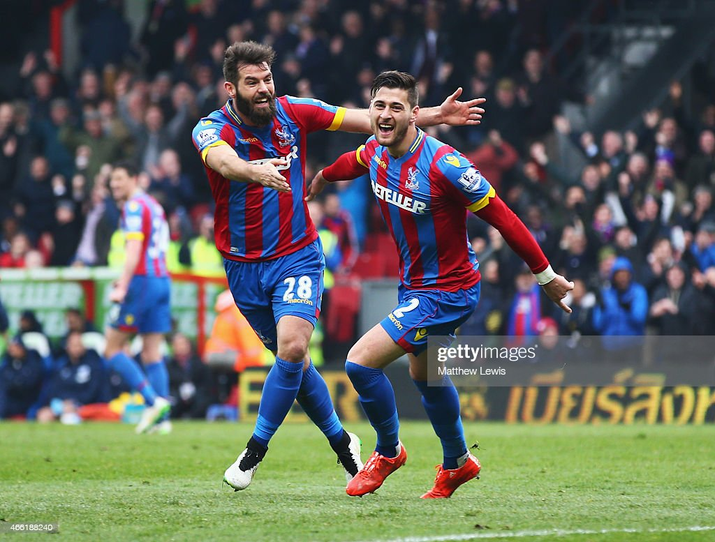 <a gi-track='captionPersonalityLinkClicked' href=/galleries/search?phrase=Joel+Ward+-+Soccer+Player&family=editorial&specificpeople=7231966 ng-click='$event.stopPropagation()'>Joel Ward</a> of Crystal Palace celebrates scoring his team's third goal with <a gi-track='captionPersonalityLinkClicked' href=/galleries/search?phrase=Joe+Ledley&family=editorial&specificpeople=687410 ng-click='$event.stopPropagation()'>Joe Ledley</a> during the Barclays Premier League match between Crystal Palace and Queens Park Rangers at Selhurst Park on March 14, 2015 in London, England.