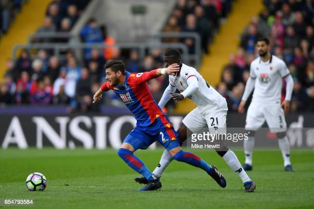 Joel Ward of Crystal Palace is tackled by M'Baye Niang of Watford during the Premier League match between Crystal Palace and Watford at Selhurst Park...