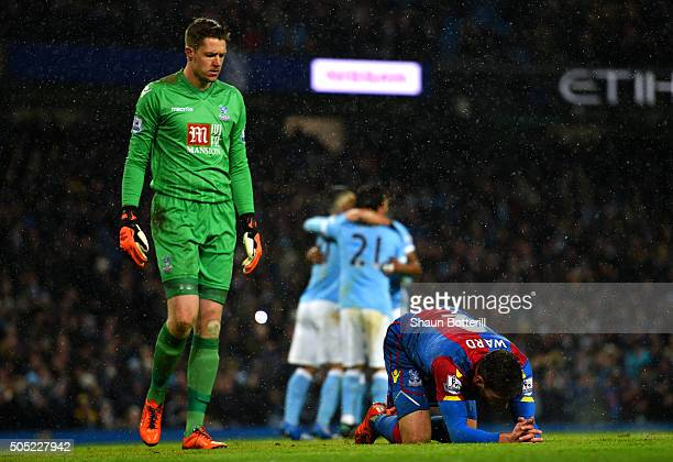 Joel Ward of Crystal Palace lies on the turf dejected as Wayne Hennessey of Crystal Palace looks on after David Silva of Manchester City scored his...