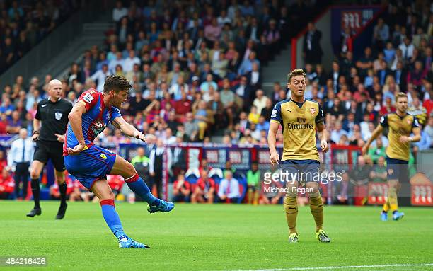 Joel Ward of Crystal Palace scores his team's opening goal during the Barclays Premier League match between Crystal Palace and Arsenal at Selhurst...