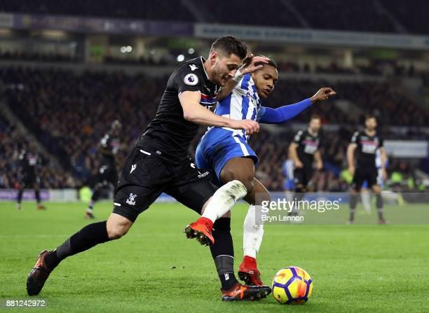 Joel Ward of Crystal Palace tackles Jose Izquierdo of Brighton Hove Albion during the Premier League match between Brighton and Hove Albion and...