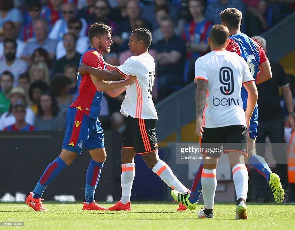 Joel Ward of Palace and Nani of Valencia argue after a challenge by Nani during the Pre Season Friendly match between Crystal Palace and Valencia at...