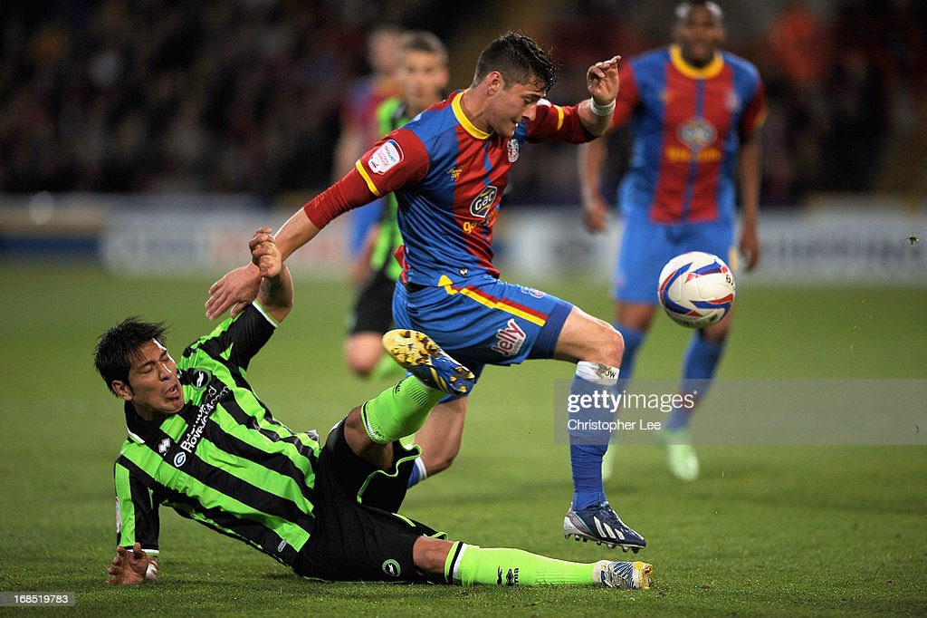 Joel Ward of Palace battles with Leonardo Ulloa of Brighton during the npower Championship Play Off Semi Final, First Leg at Selhurst Park on May 10, 2013 in London, England.