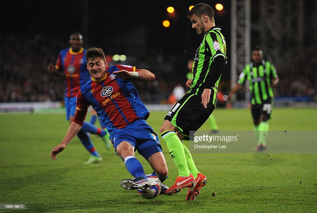 Joel Ward of Palace challenges Andrea Orlandi of Brighton during the npower Championship Play Off Semi Final, First Leg at Selhurst Park on May 10, 2013 in London, England.