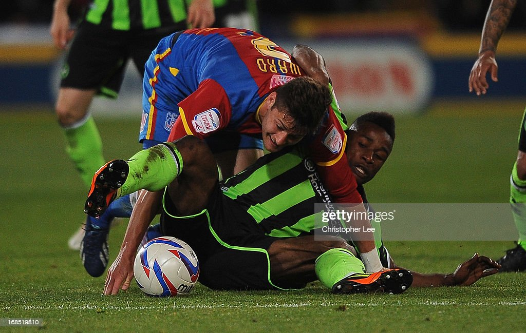 Joel Ward of Palace tussles with Kazenga LuaLua of Brighton during the npower Championship Play Off Semi Final, First Leg at Selhurst Park on May 10, 2013 in London, England.