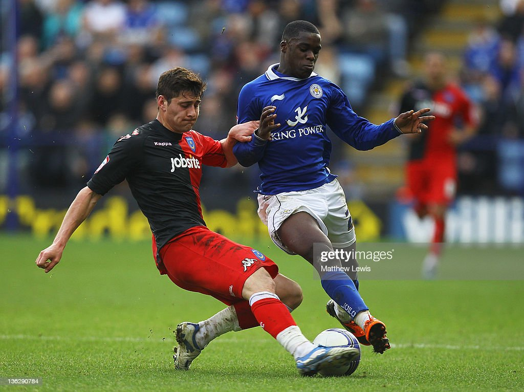 Joel Ward of Portsmouth tackles Jeff Schlupp of Leicester during the npower Championship match between Leicester City and Portsmouth at The King Power Stadium on December 31, 2011 in Leicester, England.