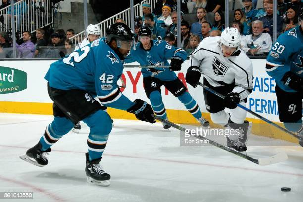 Joel Ward of the San Jose Sharks and Adrian Kempe of the Los Angeles Kings race for the puck during a NHL game at SAP Center at San Jose on October 7...