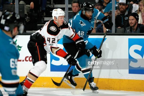 Joel Ward of the San Jose Sharks and Josh Mason of the Anaheim Ducks battle along the boards at SAP Center on November 20 2017 in San Jose California