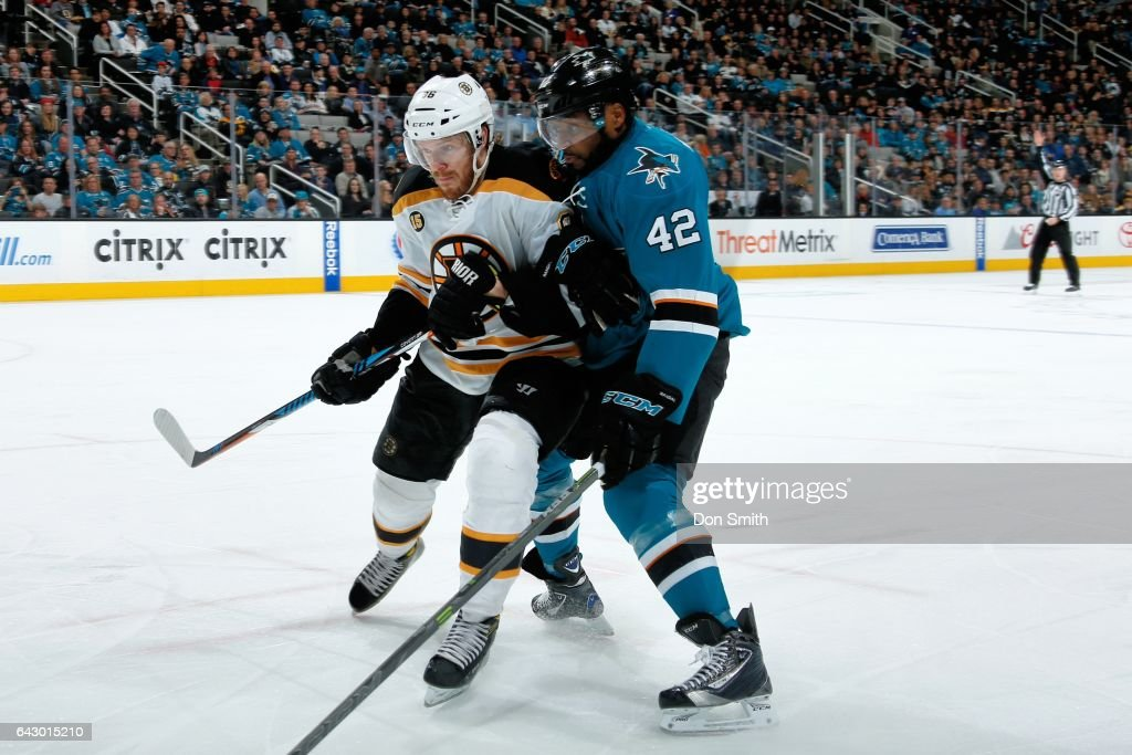 Joel Ward #42 of the San Jose Sharks and Kevan Miller #86 of the Boston Bruins battle during a NHL game at SAP Center at San Jose on February 19, 2017 in San Jose, California.