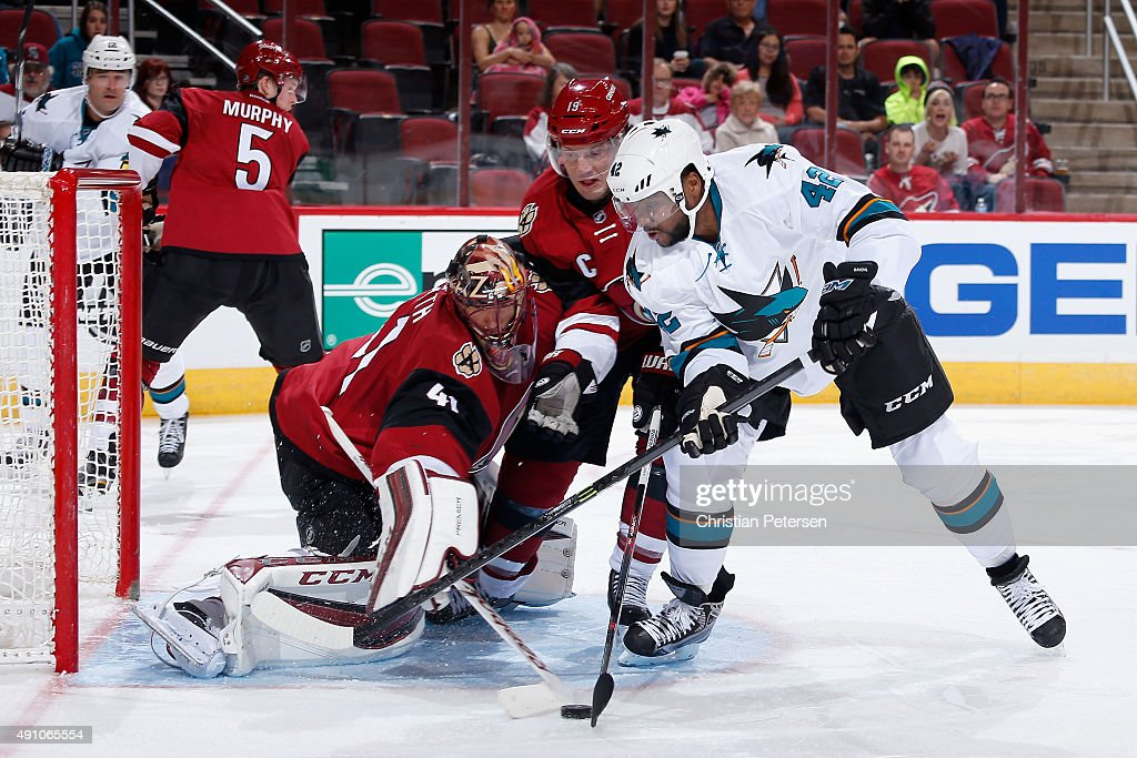 <a gi-track='captionPersonalityLinkClicked' href=/galleries/search?phrase=Joel+Ward+-+Ice+Hockey+Player&family=editorial&specificpeople=7231959 ng-click='$event.stopPropagation()'>Joel Ward</a> #42 of the San Jose Sharks attempts a shot against goaltender <a gi-track='captionPersonalityLinkClicked' href=/galleries/search?phrase=Mike+Smith+-+Ice+Hockey+Player&family=editorial&specificpeople=213785 ng-click='$event.stopPropagation()'>Mike Smith</a> #41 of the Arizona Coyotes as <a gi-track='captionPersonalityLinkClicked' href=/galleries/search?phrase=Shane+Doan&family=editorial&specificpeople=201614 ng-click='$event.stopPropagation()'>Shane Doan</a> #19 defends during the second period of the NHL preseason game at Gila River Arena on October 2, 2015 in Glendale, Arizona.