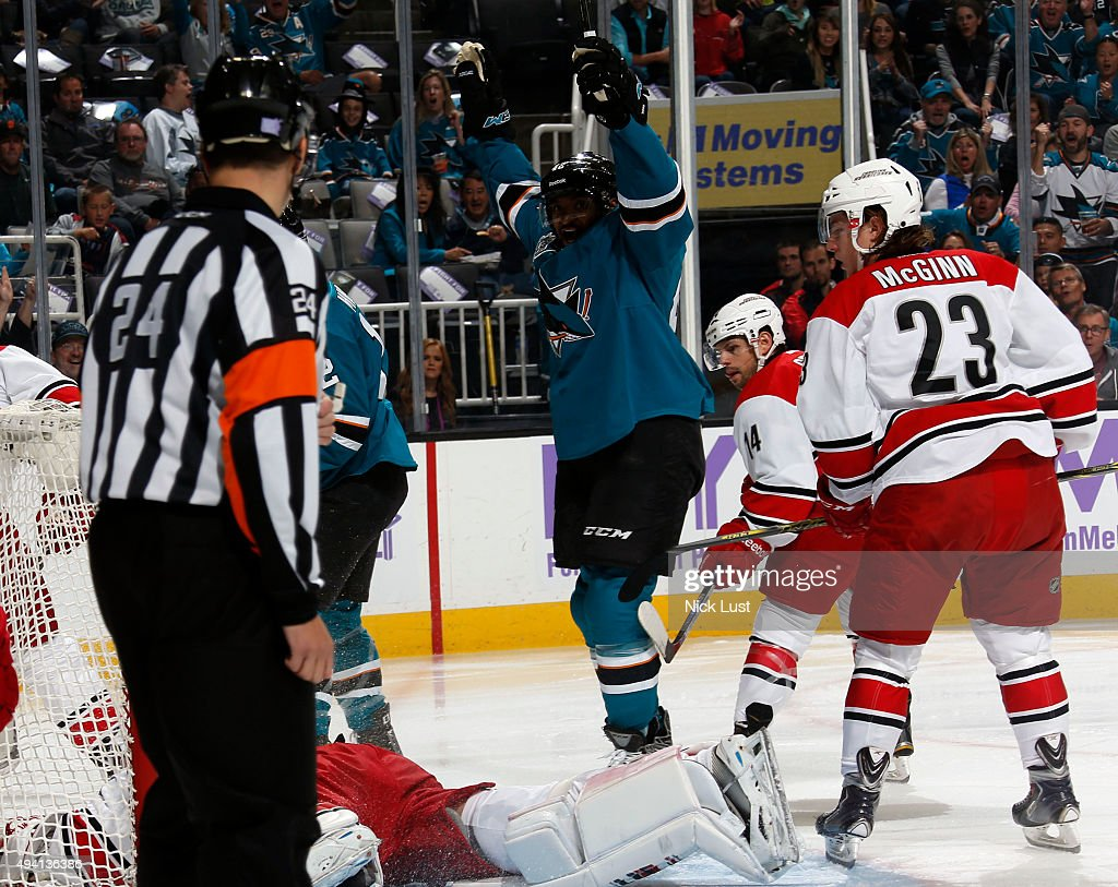 Joel Ward of the San Jose Sharks celebrates after scoring the first goal of the game against Brock McGinn Nathan Gerbe and Eddie Lack of the Carolina...