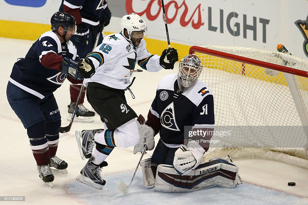 Joel Ward of the San Jose Sharks celebrates as he beats Francois Beauchemin of the Colorado Avalanche and scores a goal against goalie Calvin Pickard...