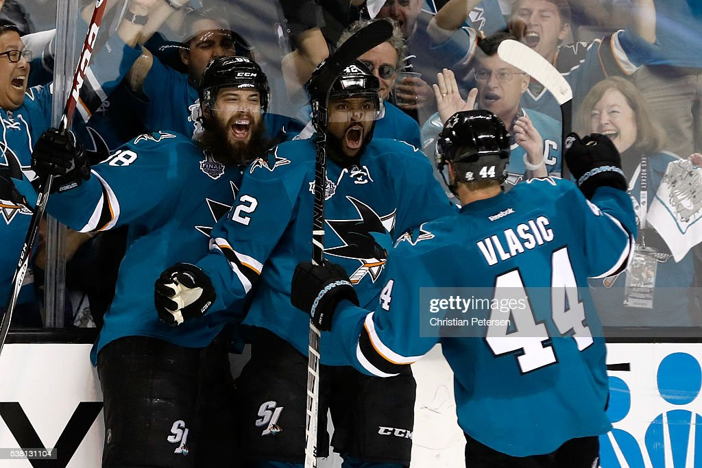 Joel Ward of the San Jose Sharks celebrates his goal with Brent Burns and MarcEdouard Vlasic against the Pittsburgh Penguins during the third period...