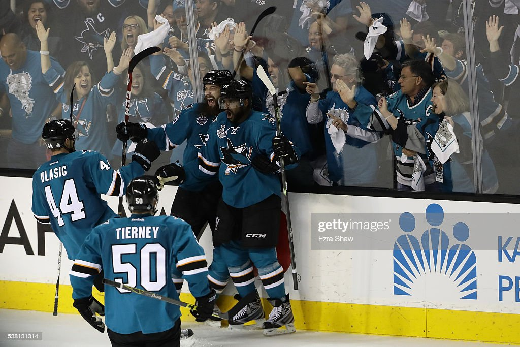 Joel Ward of the San Jose Sharks celebrates his goal with Brent Burns MarcEdouard Vlasic and Chris Tierney against the Pittsburgh Penguins during the...