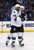 Joel Ward of the San Jose Sharks celebrates with Joonas Donskoi after scoring a second period goal against the St Louis Blues in Game Five of the...