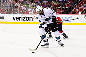 Joel Ward of the San Jose Sharks controls the puck against the Washington Capitals in the third period during an NHL game at Verizon Center on...