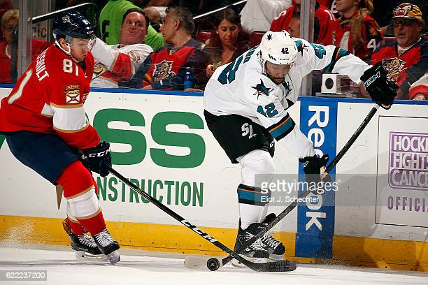 Joel Ward of the San Jose Sharks crosses sticks with Jonathan Marchessault of the Florida Panthers at the BBT Center on November 10 2016 in Sunrise...
