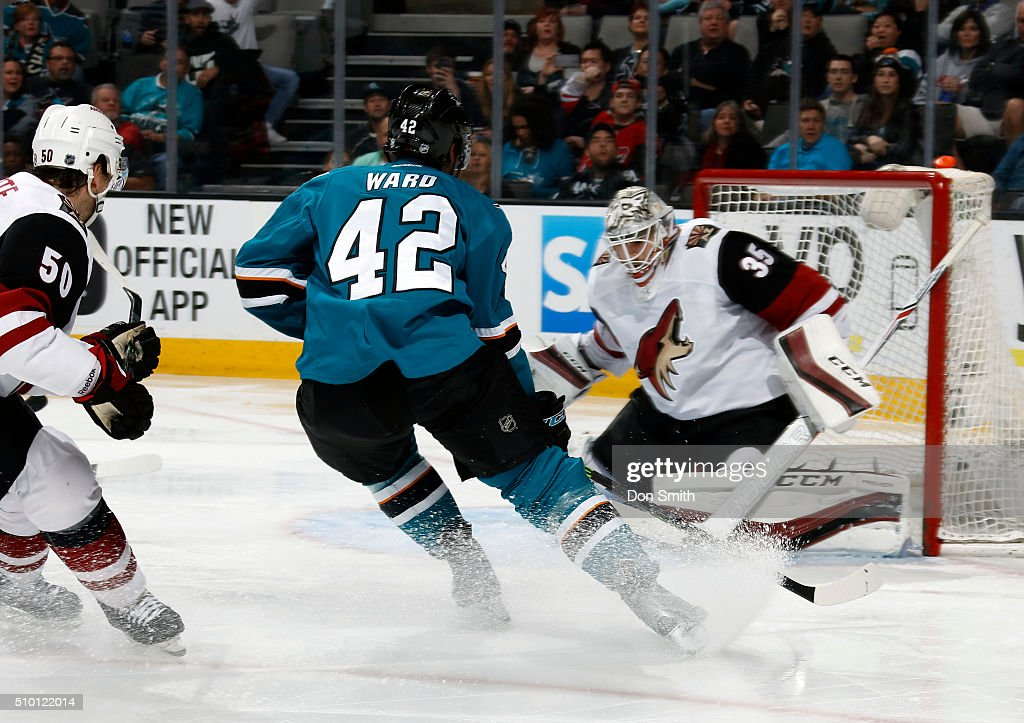 Joel Ward #42 of the San Jose Sharks cuts up toward the net of the Arizona Coyotes during a NHL game at the SAP Center at San Jose on February 13, 2016 in San Jose, California.